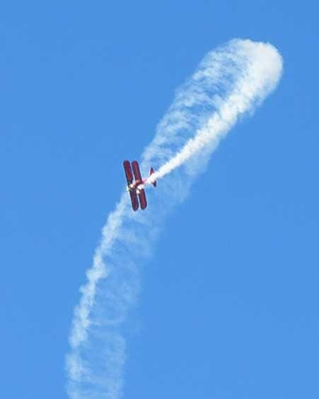 Red Baron airplane does loops in the sky-min