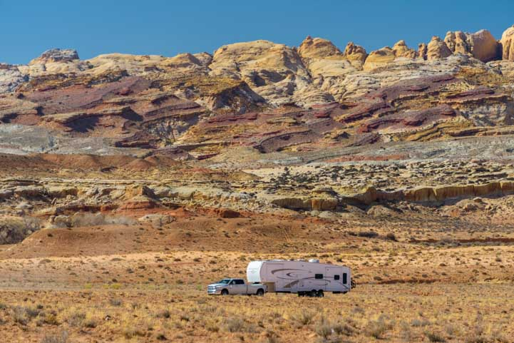 RV fifth wheel trailer driving in Utah red rocks-min