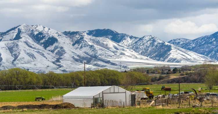 Farmhouses and snowcapped mountains RV trip Logan Utah-min