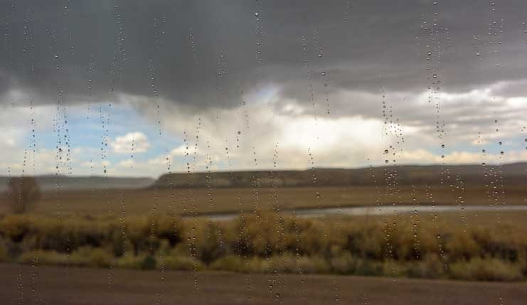 Rain drops on our RV window in Wyoming-min