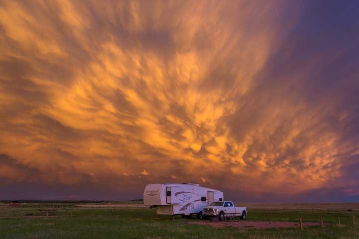 Gorgeous sunset over fifth wheel trailer RV-min