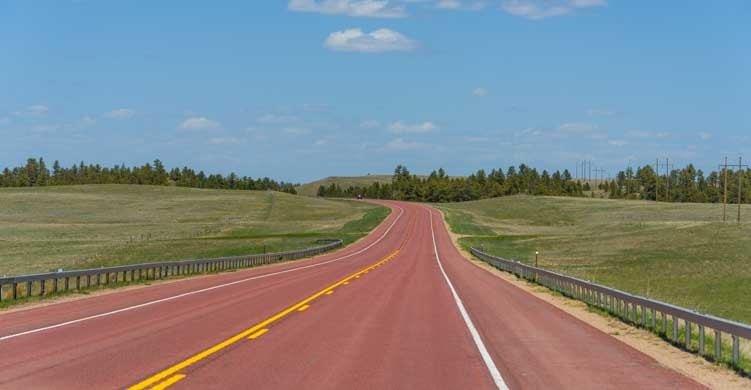 Red asphalt highway in Wyoming-min