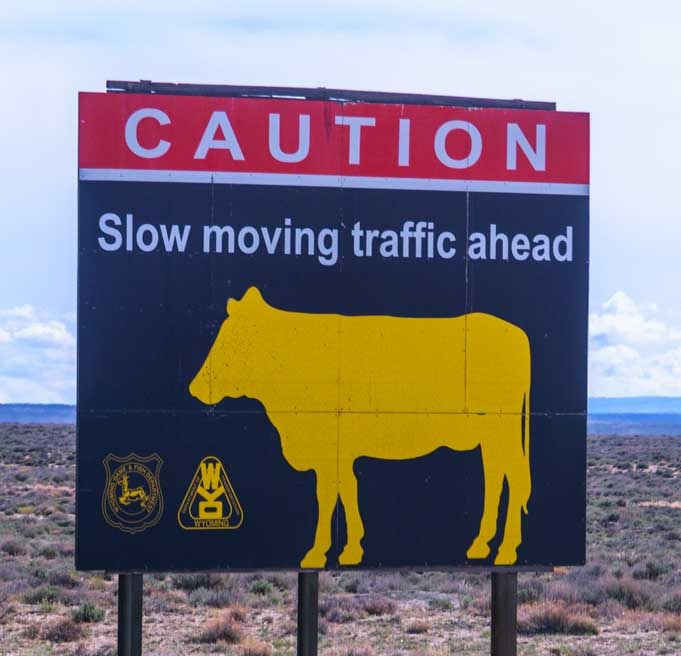Road sign rural Wyoming RV trip Slow traffic-min
