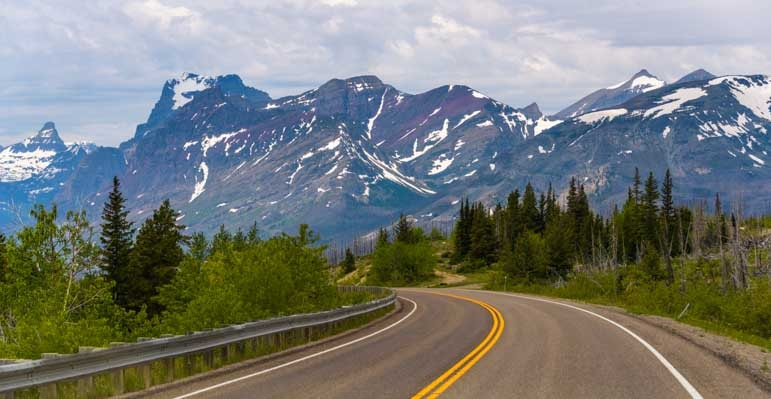 Mountain views east Glacier National Park scenic drive in an RV-min