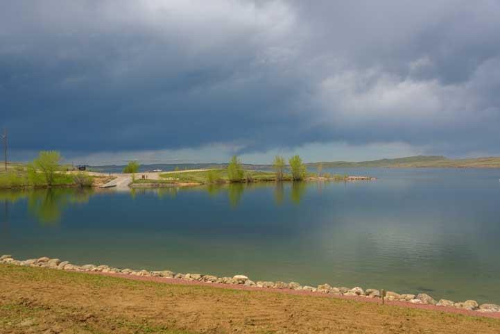 Cloudy sky reflections De Smet Lake Wyoming RV trip-min