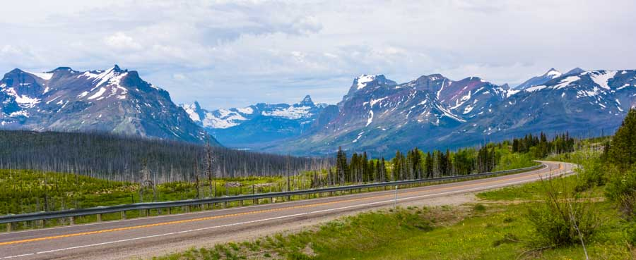 Snowy mountains east Glacier National Park scenic drive in an RV-min
