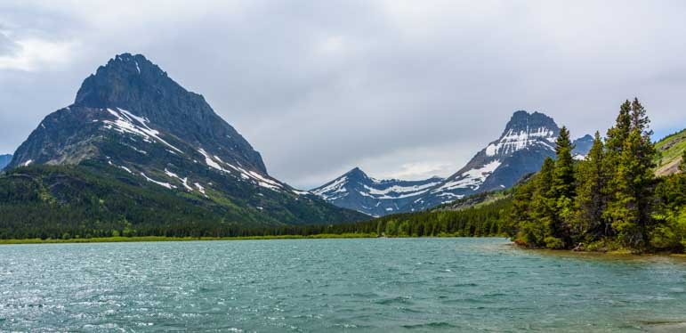 Mountains at Swiftcurrent Lake Many Glacier Entrance of Glacier National Park Montana-min