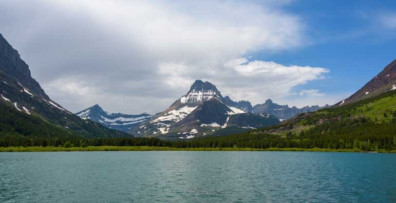 Glacier carved valleys across Swiftcurrent Lake Many Glacier National Park Montana-min