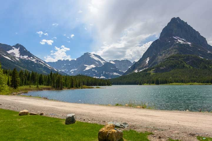 Beach at Swiftcurrent Lake in Many Glacier section of Glacier National Park Montana-min