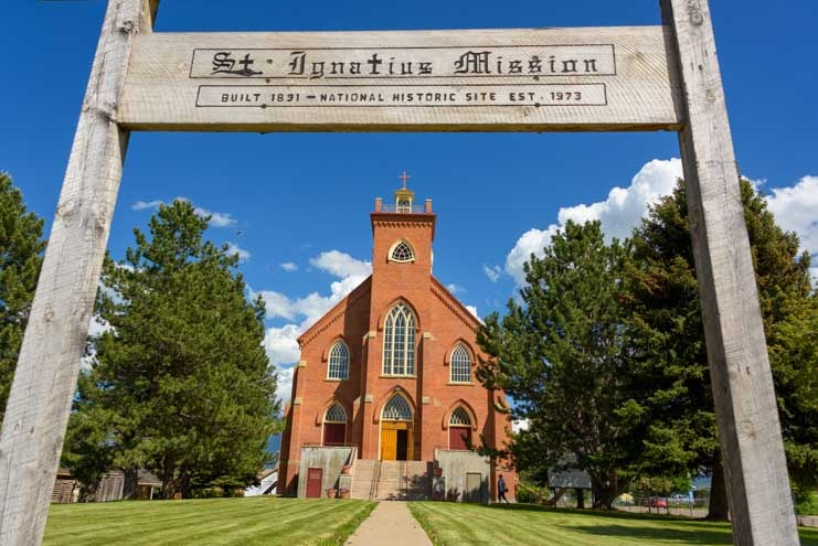 St. Ignatius Mission Montana with wooden sign-min
