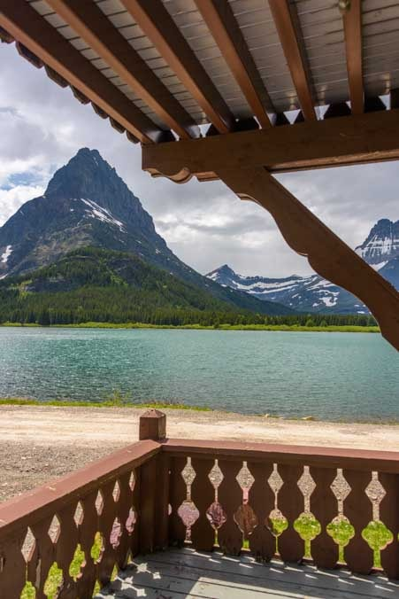 Balcony view of Swiftcurrent Lake at Many Glaicer Hotel in Glacier National Park Montana-min