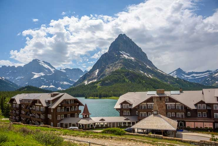 Swiss Chalet style Many Glacier Hotel on Swiftcurrent Lake Glacier National Park Montana-min