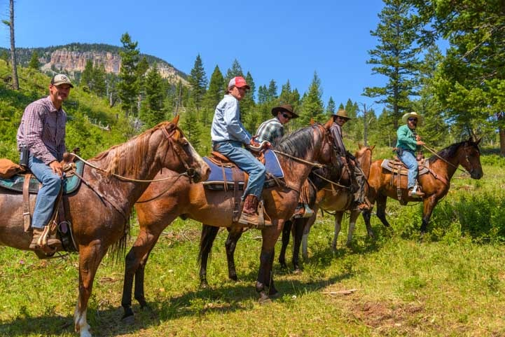 Horseback riders Chief Joseph Scenic Byway Wyoming RV Trip-min