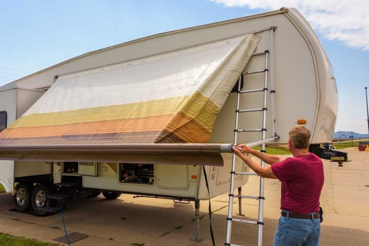 Ripped RV awning torn before replacement-min