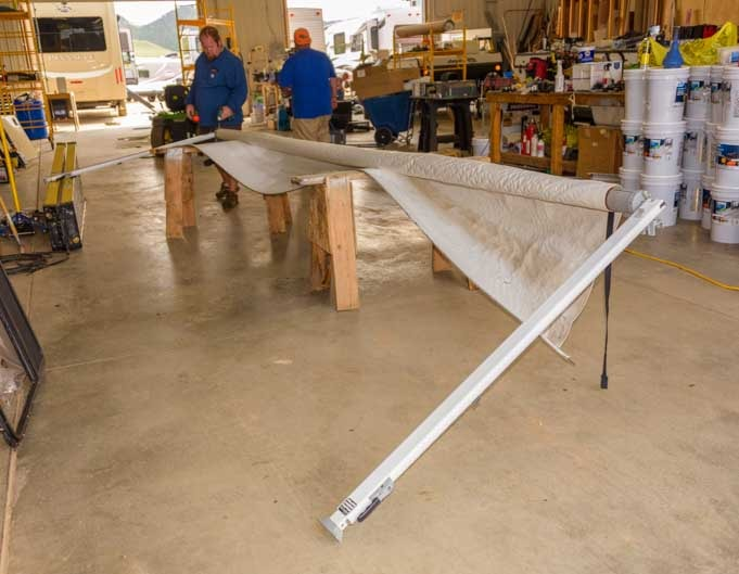Rest the RV awning on saw horses to remove the fabric-min