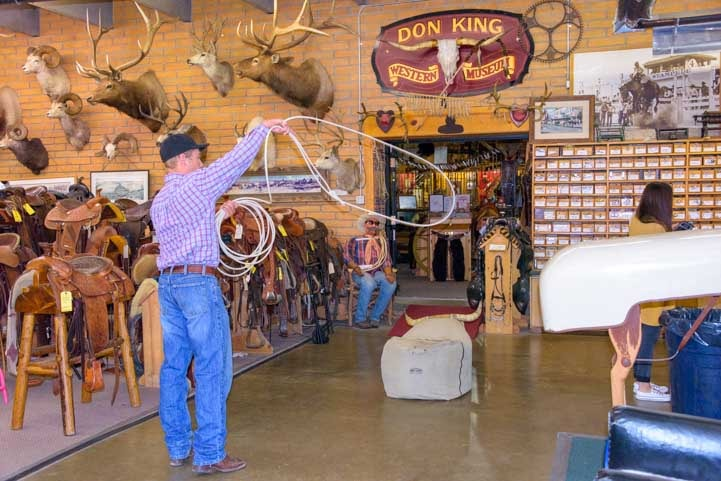 Cowboy tests ropes at King's Saddlery Sheridan Wyoming-min-min