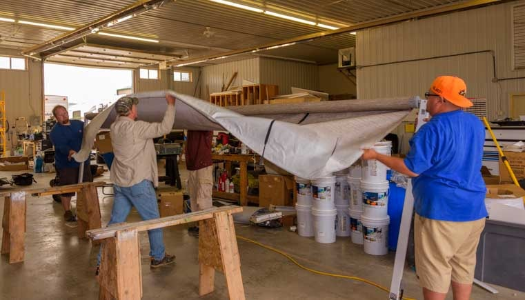 Wrap the new RV awning fabric around the roller-min