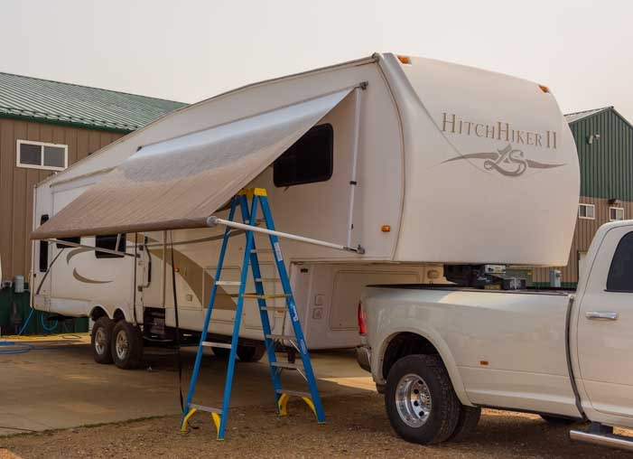 New RV awning installed on our fifth wheel trailer RV-min