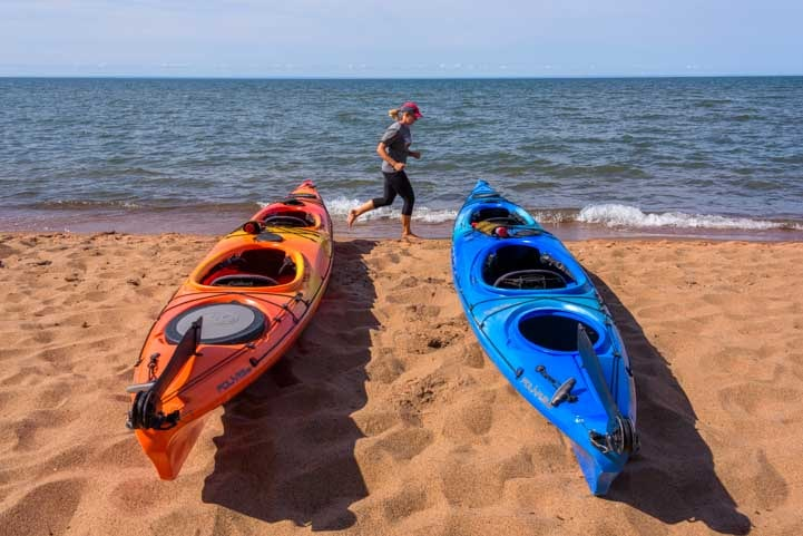 Kayaks on the beach on Lake Superior in Wisconsin-min
