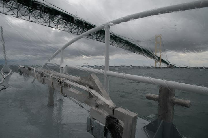 Sheppler's Ferry under the Mackinac Bridge in a storm-min