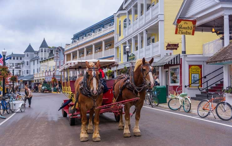 Quaint horse drawn wagon Mackinac Island Michigan-min