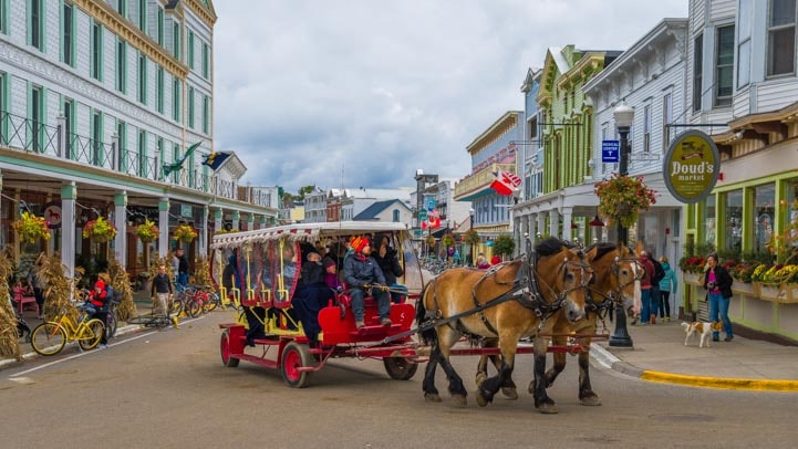 Horse drawn wagon on Mackinac Island Michigan main street-min