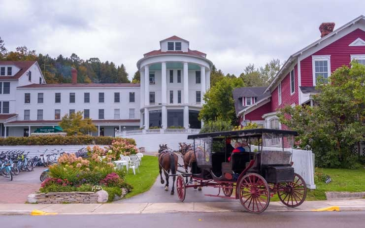 Returning horse drawn wagon Mackinac Island Michigan-min