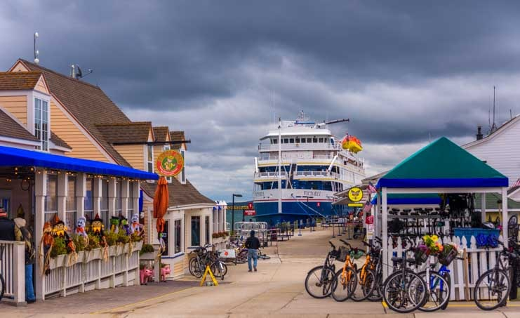 Cruise ship under storm clouds Mackinac Island Michigan-min