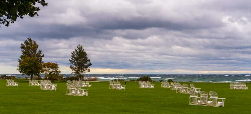 Summer chairs under storm clouds Mackinac Island Michigan-min