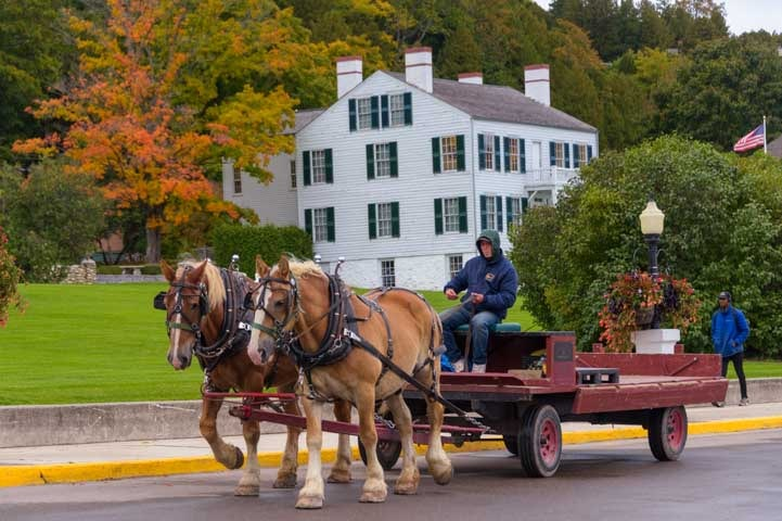 Fall color and horse drawn wagon Mackinac Island Michigan-min