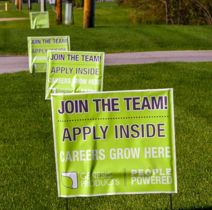 Hiring signs in Elkhart Indiana as economy booms-min