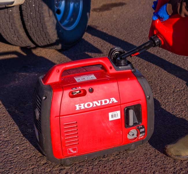 Putting gas in a Honda EU2200i Generator-min
