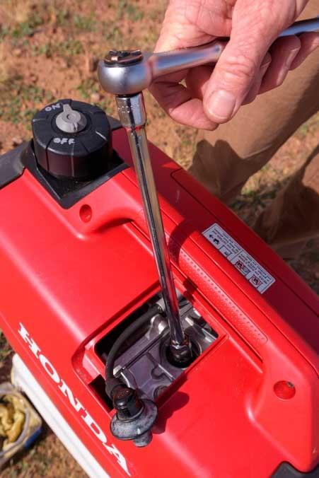 Remove spark plug from Honda EU2200i Generator-min