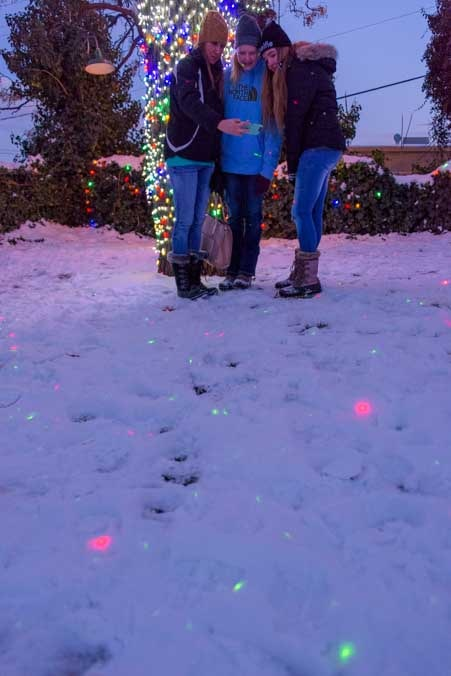 Christmas lights buried under the snow-min