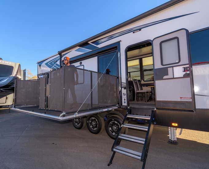 Road Warrior toy hauler with side patio deck-min