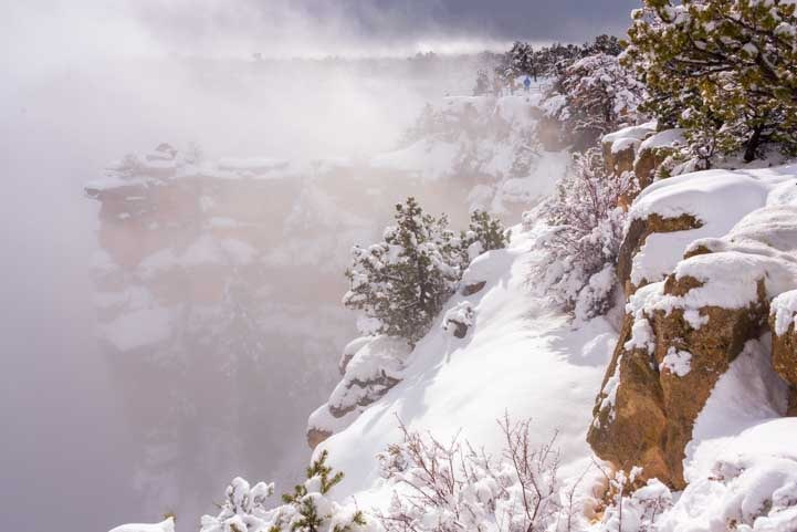 Drifts and blowing snow at Grand Canyon National Park overlook in snow-min
