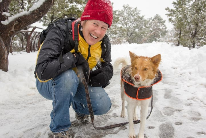 Happy camper and puppy in snow-min