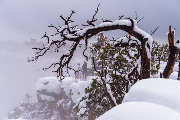 Photographer in snow at Grand Canyon National Park-min