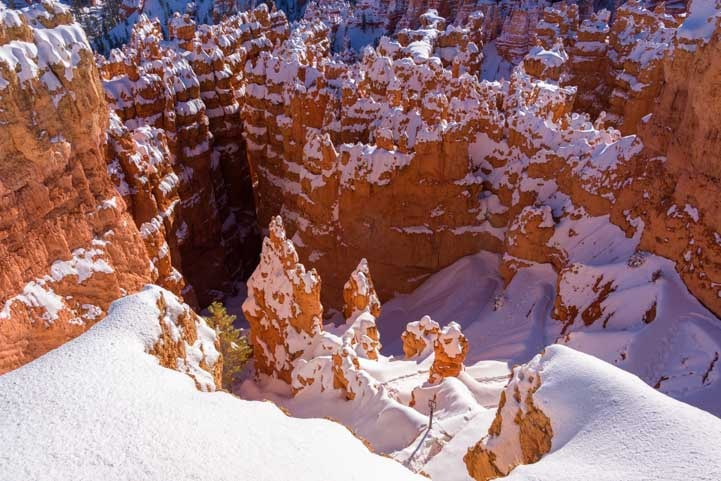 Looking down into the snow at Bryce Canyon National Park-min
