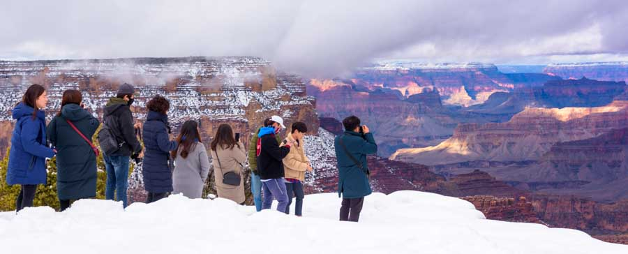 Tourists at Grand Canyon National Park in snow-min