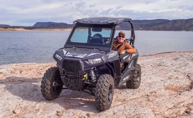 Happy camper in a Polaris RZR 900 EPS XC UTV-min