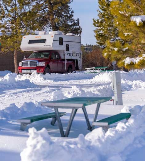 Truck camper in snow Rubys Inn Bryce Canyon National Park-min