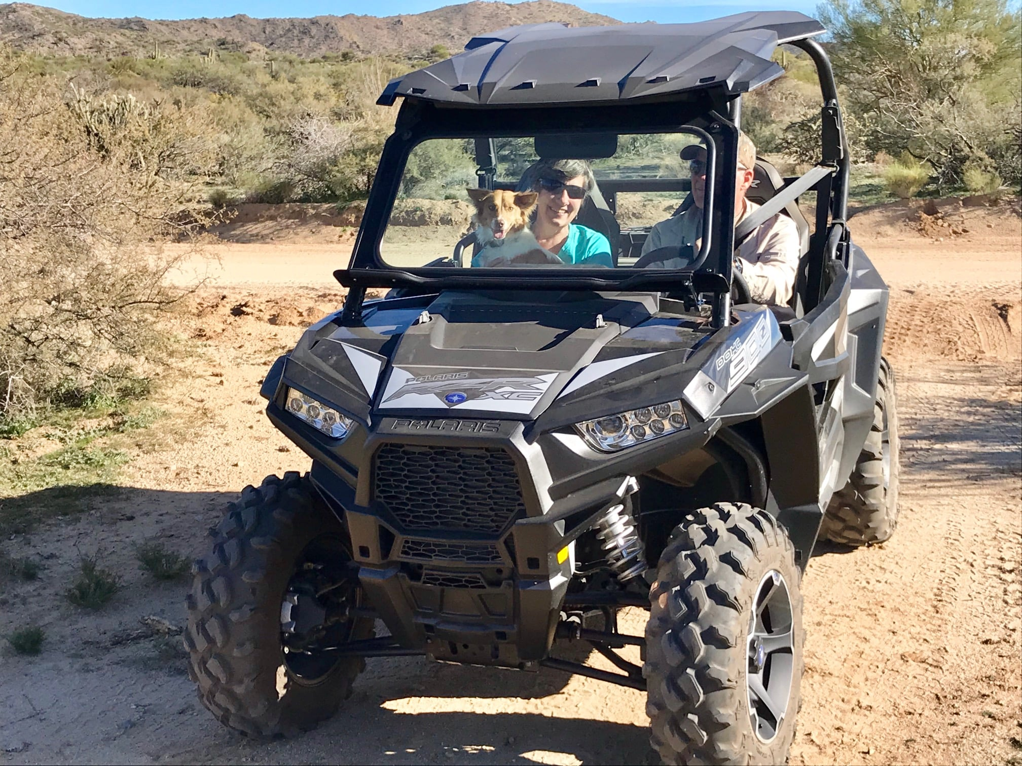 Happy campers in a Polaris RZR 900 EPS XC Edition UTV