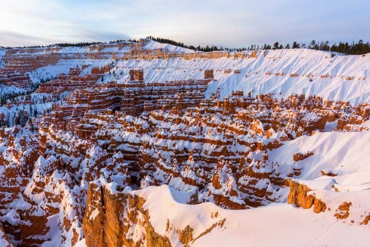 Morning light Bryce Canyon National Park with snow in winter-min