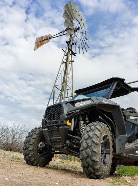 Polaris RZR and old wind mill-min