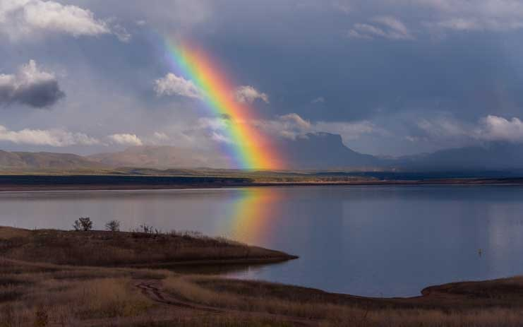 Reflecting rainbow Roosevelt Lake Arizona-min