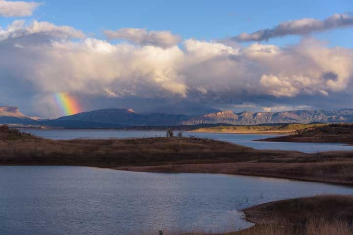 Storm clouds and rainbow at Roosevelt Lake Arizona-min