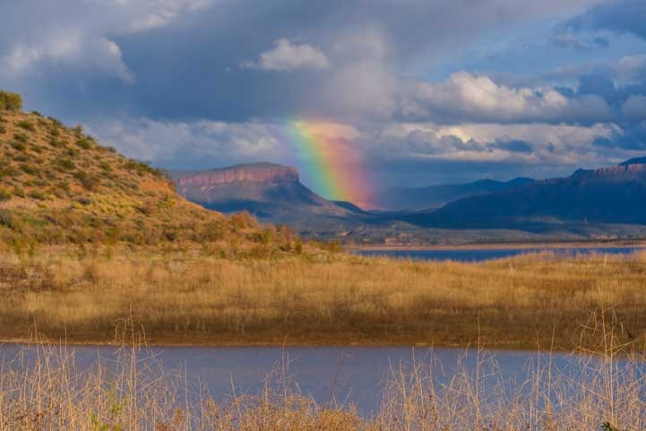 Rainbow and clouds at Roosevelt Lake Arizona-min