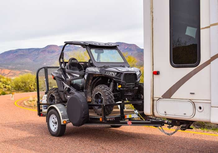 Triple tow Polaris RZR 900 behind fifth wheel trailer-min
