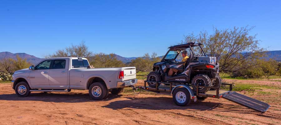 Dodge Ram dually tows Polaris RZR on trailer-min